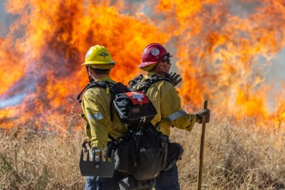 Los Angeles County firefighters prepare to battle the Jake Fire near the top of Dockweiler Drive in Newhall Wednesday afternoon. | Photo: Cory Rubin / The Signal.