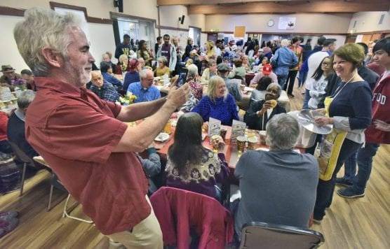 SCV Senior Center Executive Director Kevin MacDonald, left, takes a picture of volunteers as they serve some of the hundreds of seniors on hand for the 2018 Thanksgiving Party & Feast at the SCV Senior Center on Thursday, November 22, 2018. | Photo: Dan Watson / The Signal.