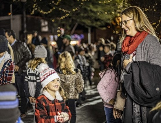 Qiana Tarlow (right) and her daughter Avalon (left) visited the snow brought in to Old Town Newhall for the Light Up Main Street celebration Saturday night, November 23, 2019. | Photo: Bobby Block / The Signal.
