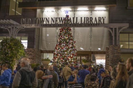 A 23-foot-tall Christmas tree in front of the Old Town Newhall Library was lit as the Light Up Main Street holiday celebration kicked off Saturday night, November 23, 2019. | Photo: Bobby Block / The Signal.