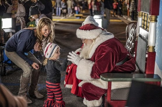 Megan Maertz (left) and her daughter Marlee visit Santa Claus during the Light Up Main Street celebration held in Old Town Newhall Saturday night, November 23, 2019. | Photo: Bobby Block / The Signal.