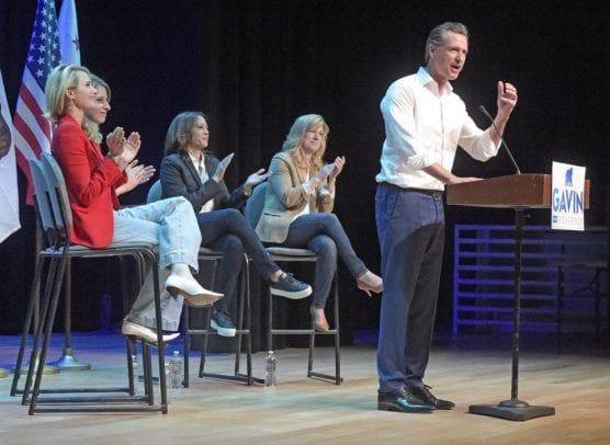 special election - Gavin Newsom, then-candidate for Governor of California, speaks at the podium during a campaign rally held at the Newhall Family Theater in Newhall on Saturday, November 3rd, 2018, as he is applauded by (from left): Newsom's wife Jennifer Siebel Newsom; Katie Hill, candidate for Congress; Kamala Harris, U.S. Senator; and Christy Smith, candidate for California Assembly. | Photo: Dan Watson / The Signal.