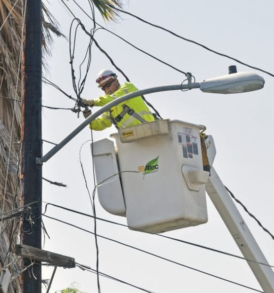 A workman in a cherry picker works on power lines that were blown down in high winds in Newhall on October 13, 2019. | Photo: Dan Watson / The Signal.