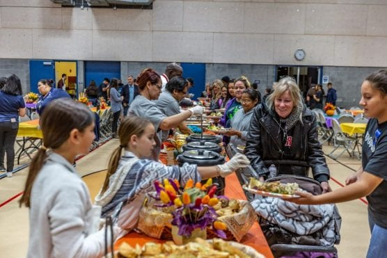 Volunteers dish up Thanksgiving dinner courtesy of the City of Santa Clarita and Parkway Motors at a Thanksgiving Community Dinner at the Newhall Community Center Monday night. | Photo: Cory Rubin / The Signal.