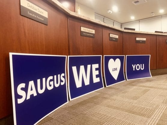 Poster boards honoring the victims of the Saugus High Shooting rest at the front of the Hart Governing Board room Wednesday night, Nov. 20, 2019. | Photo: Caleb Lunetta / The Signal.