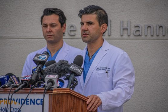 Holy Cross Dr. Evan Valle, left, and Dr. Boris Borazjani provide an update Friday morning on the wounded victims of the Saugus High School shooting. | Photo: Tammy Murga / The Signal.