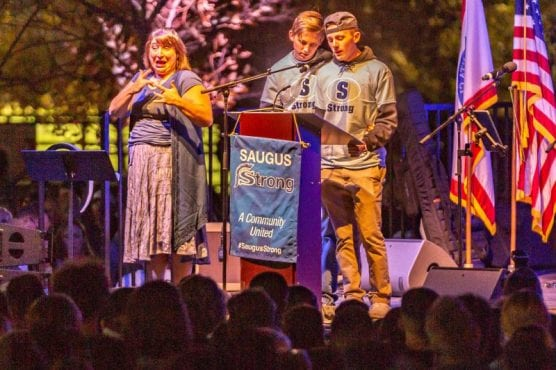 Riley and Brady Muehlberger give a tearful speech about their sister, Gracie Anne Muehlberger at the Saugus Strong Vigil Sunday night. | Photo: Cory Rubin / The Signal.