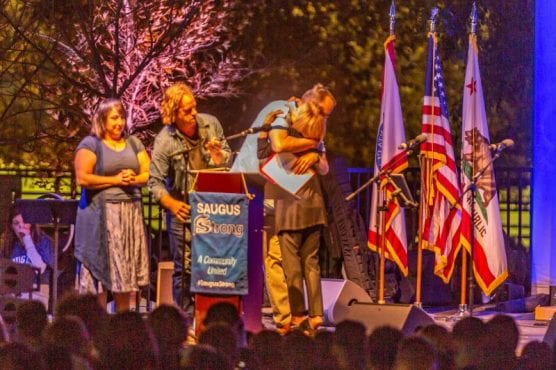 William S. Hart School District Superintendent Vicki Engbrecht embraces Saugus High School Principal Vince Ferry at the Saugus Strong Vigil Sunday night. | Photo: Cory Rubin / The Signal.