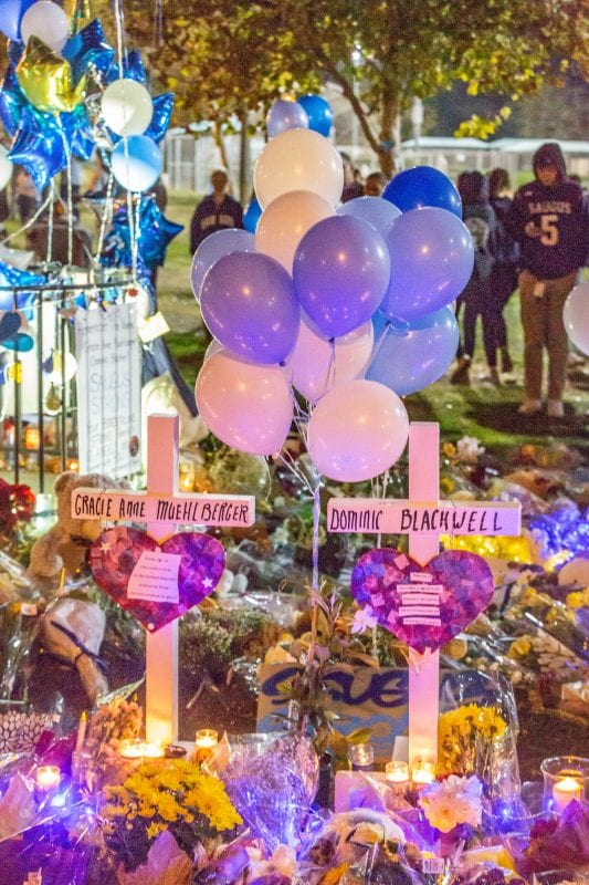 Two crosses sit at the memorial set up at the Central Park flag pole at the Saugus Strong Vigil Sunday night. | Photo: Cory Rubin / The Signal.