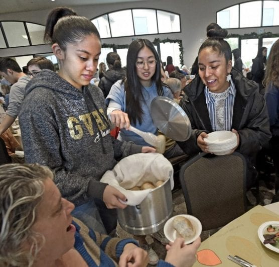 Golden Valley High School students, from left, Alicia Ulloa, Calissa Trongnetrpunya and Herione Quintos serve rolls during the Senior Center Thanksgiving Gourmet Feast and Party held at the Santa Clarita Valley Senior Center at Bella Vida on Thursday, November 28, 2019.   Photo: Dan Watson / The Signal.