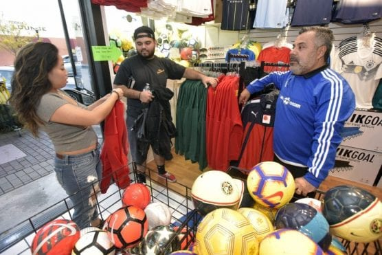 Planet Soccer owner Carlos Marroquin, right, helps shoppers Abby Buenafe, left, and Santiago Guzman as they pick out sweatshirts on Small Business Saturday at Planet Soccer in Newhall on Saturday, November 24, 2018. | Photo: Dan Watson / The Signal.
