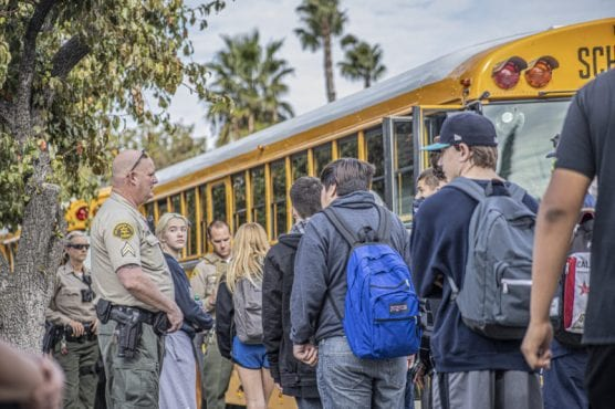Students streaming out of Saugus High School walk toward a line of buses waiting to evacuate them to a safe location following a shooting that killed at least two Thursday morning. November 14, 2019. | Photo: Bobby Block / The Signal.