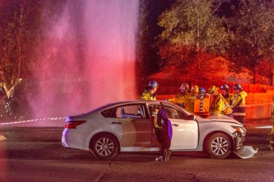 Firefighters and EMTs treat a woman involved in a two-car crash on the corner of Whites Canyon Road and Ashboro Thursday night. | Photo: Cory Rubin/The Signal.