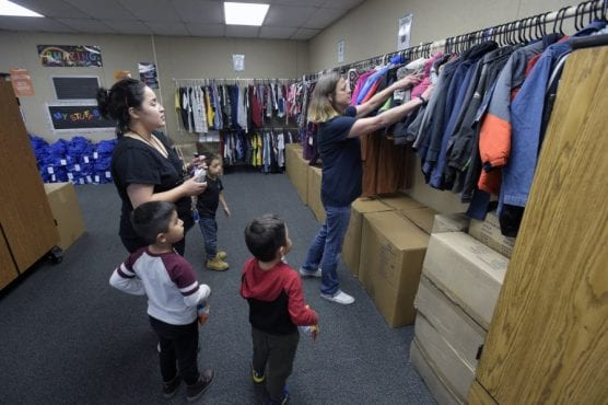 District Coordinator of Special Programs Sarah Johnson, right, shows Maria Velez and her three sons, from left, Jaden, Steven and Hector Lemus the coats available as they are the first family to visit the Wiley Canyon Elementary School Family Resource Center in Newhall on Thursday, November 21, 2019. | Photo: Dan Watson / The Signal.