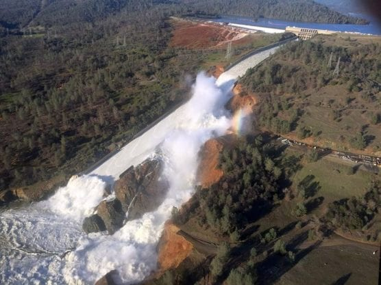 water plan - View of Oroville Dam's main spillway (center) and emergency spillway (top), on Feb. 11, 2017. The large gully to the right of the main spillway was caused by water flowing through its damaged concrete surface. | Photo: William Croyle/California Department of Water Resources – California Department of Water Resources.