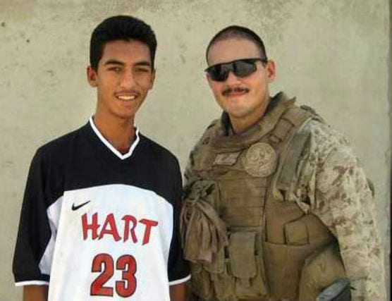 Ernesto Trevizo with a young man wearing a Hart shirt in Ramadi, Iraq, in 2008. | Courtesy photo.