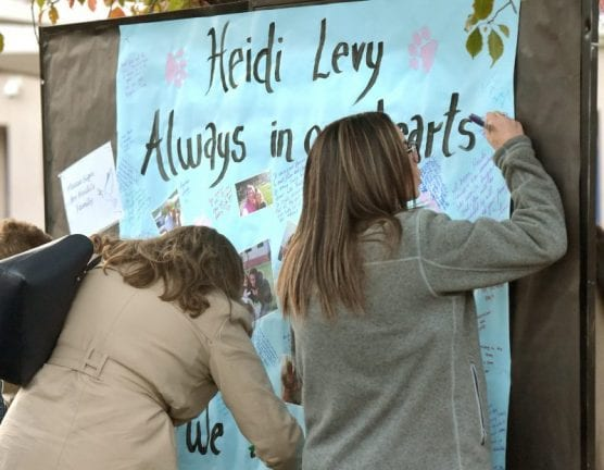 Attendees sign a poster for the family of Heidi Levy during her memorial held at Bowman High School on Thursday, December 19, 2019.   Photo: Dan Watson / The Signal.