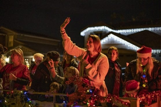 """Carolers led by Cindy Muehlberger pull up to a house Wednesday night as part of the """"Caroling with Gracie"""" event which aims to collect non-perishable foods for Hart District students in need while honoring the memory of Muehlberger's daughter Gracie, who was murdered in the Saugus High School shooting on November 14. 