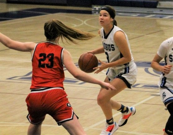 Saugus girls basketball player Libbie McMahan drives to the hoop in a game against Glendora at Sierra Canyon High School on Thursday. | Photo: Haley Sawyer / The Signal.