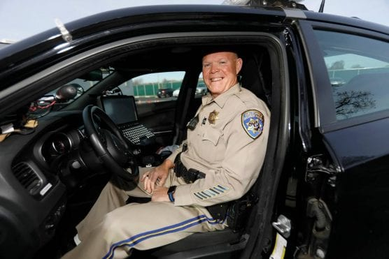 Officer Doug Villars is pictured sitting in his patrol unit on the last day of his career at the California Highway Patrol on Friday, December 20, 2019. | Photo: Laura Dickinson / LDICKINSON@THETRIBUNENEWS.COM.