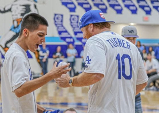 A student at Saugus High School expresses joy as he is handed a signed baseball from Los Angeles Dodgers player Justin Turner (10) at a pep rally where the team visited his school on January 24, 2020. | Photo: Bobby Block / The Signal.