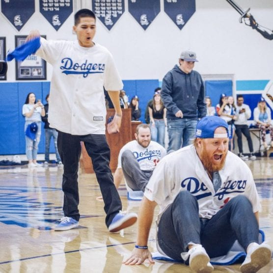 A student at Saugus High School teams up with Los Angeles Dodgers player Justin Turner (10) at a pep rally when the team visited the school on January 24, 2020. | Photo: Tammy Murga / The Signal.