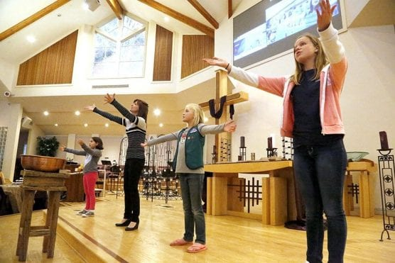"""From right to left, Mandy Eckelman, 13, Sophie Avagliano, 8, director of family ministries Karyn Malchus and Liana Rosales, 7, sing """"He Is Our King"""" at the beginning of a family Ash Wednesday service at Valencia United Methodist Church on Wednesday, Feb. 14, 2018. 