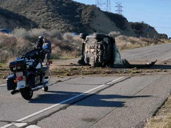 rollover crash - A sedan flipped off of southbound Highway 14, landing on the Placerita Canyon Road on-ramp just after 9 a.m. on Monday, Jan. 13, 2020.   Photo: Gilbert Bernal / The Signal.