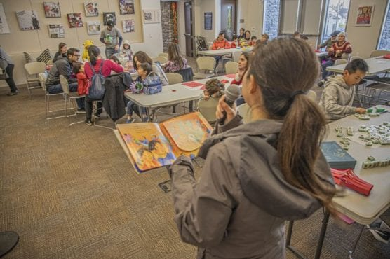 Zheng Lin Diao, a teacher at the SCV Chinese School, reads from a children's book at the school's Chinese New Year Celebration held at the Newhall Library on Saturday, January 18, 2020. | Photo: Bobby Block / The Signal.
