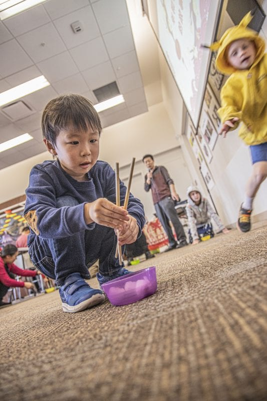 Dax Seki, age 4, participates in a chopstick relay race at the SCV Chinese School's Chinese New Year celebration at the Newhall Library on Saturday, January 18, 2020. | Photo: Bobby Block / The Signal.