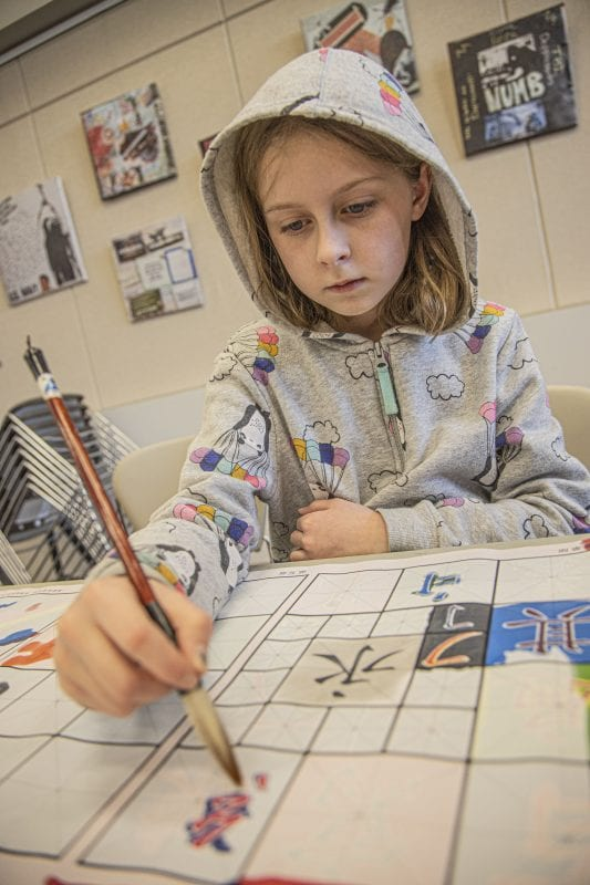 Alex Anderson, age 9, paints newly learned Chinese characters at the SCV Chinese School's Chinese New Year Celebration at the Newhall Library on Saturday, January 18, 2020. | Photo: Bobby Block / The Signal.