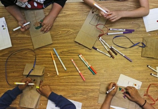 Kids create kites out of paper bags, drawing their wishes for the future on the bags, during Saugus High School's Students Matter Club's Sunshine Day Camp at Stevenson Ranch Elementary School on Friday, April 7, 2017. | Photo: Katharine Lotze / The Signal.