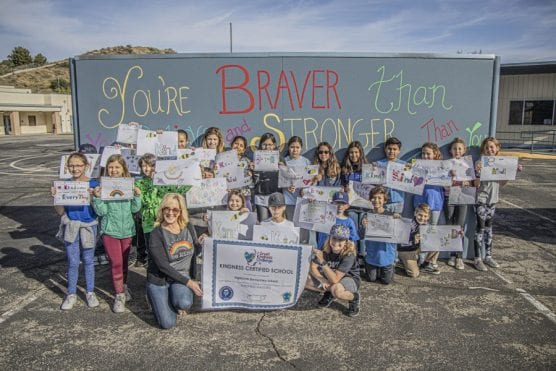 kindness challenge - Fifth-grade students at Highlands Elementary School hold up art they submitted for a handball court repainting project as part of the school's participation in the Great Kindness Challenge on January 30, 2020. | Photo: Bobby Block / The Signal.