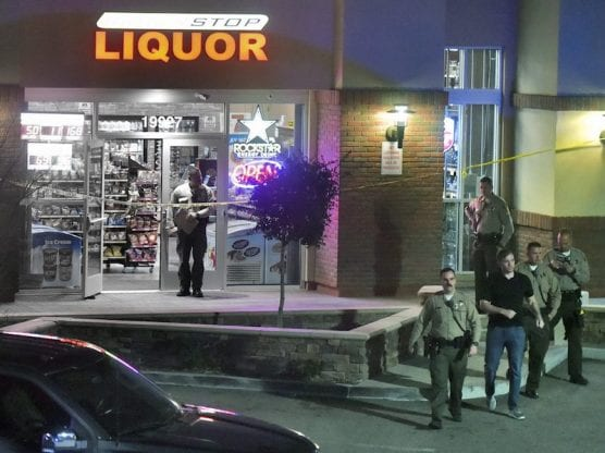burris - Sheriff's deputies investigate a shooting at a liquor store at the corner of Golden Valley Road and Sierra Highway on Saturday night, February 02, 2020. | Photo: Dan Watson / The Signal.