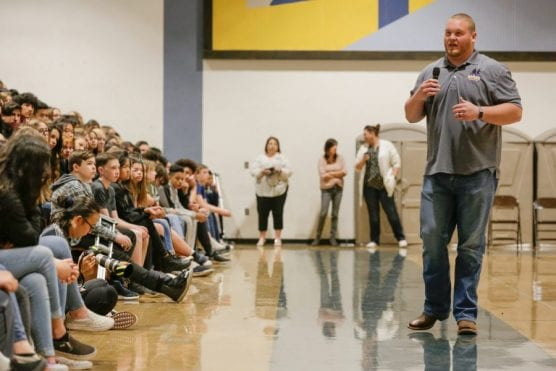 Bradley Bozeman speaks to teens about maintaining a positive attitude in the face of challenges and obstacles in way of goals and dreams inside the gym at Castaic Middle School, Wednesday, Feb. 26, 2020. | Photo: Gilbert Bernal / The Signal.