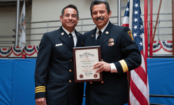 Los Angeles Fire Department Assistant Chief Ellsworth Fortman (left) poses for a photo at a Dec. 6, 2018 Los Angeles Fire Department promotion ceremony. | Photo: Gary Apodaca.