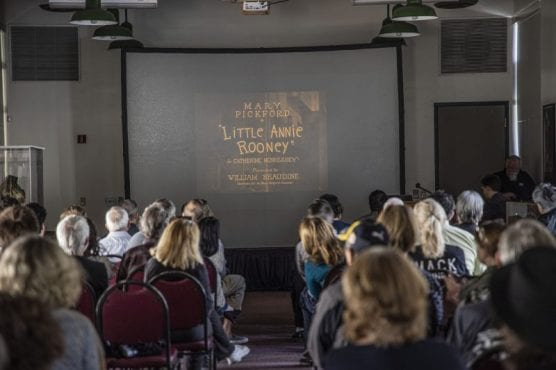 Residents watch silent films in a historic building at Hart Park in Newhall as part of the William S. Hart Museum's three-day Newhollywood Silent Film Festival on Saturday afternoon, February 15, 2020. | Photo: Bobby Block / The Signal.