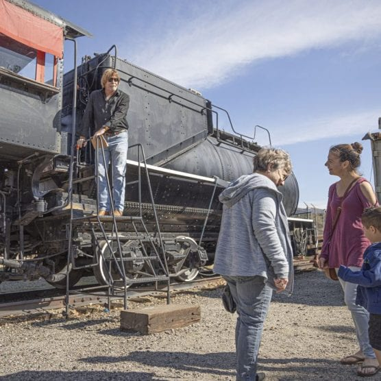Vaughan Gibson, a docent at the William S. Hart Museum gives a guided tour of a locomotive to a group of guests visiting the Hart Park for the Newhallywood Silent Film Festival Saturday afternoon, February 15, 2020. | Photo: Bobby Block / The Signal.
