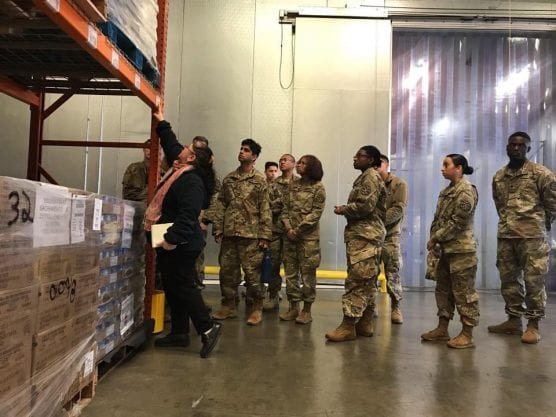 national guard - Members of the 115th Regional Support Group, California Army National Guard, receive a brief from Sandra Yahya, warehouse and inventory manager of Sacramento Food Bank & Family Services, on Friday, March 20, 2020. The Sacramento warehouse supplies tens of thousands of northern California residents. Guardsmen are activated to assist the food bank prepare and package supplies to send out to the community.   Photo: U.S. Army photo by Staff Sgt. Eddie Siguenza.