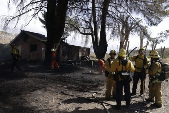 structure fire - Los Angeles County Fire Department officials battle a structure fire that spread to the surrounding brush on the 9900 block of Soledad Canyon Road in Canyon Country on Monday, March 2, 2020. | Photo: Gilbert Bernal / The Signal.