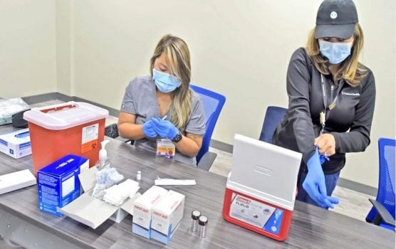 Nurses Getting Ready to Administer Vaccine