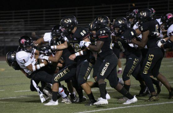 Golden Valley players tackle Rio Mesa's Meshylom Tili